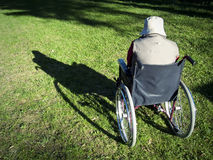 Adventure. Crippled person sitting on a wheelchair Royalty Free Stock Photos