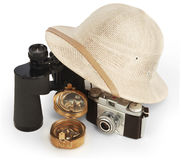 Adventure. Safari pith helmet leaning against binoculars isolated on white background with brass compass and vintage view camera Royalty Free Stock Image