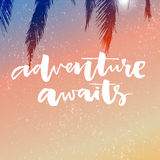 Adventure awaits. Inspirational saying about travel and vacation. Modern brush calligraphy on pink and orange gradient Stock Images