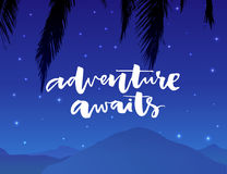 Adventure awaits. Inspirational saying about travel and vacation. Modern typography on night landscape background with Royalty Free Stock Image