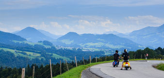 The adventure awaits. Two young bikers continuing the adventure after a quick stop in the mountains, Vorarlberg, Austria Stock Photography