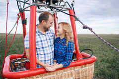Adventure. Beautiful romantic couple hugging in bascket hot air balloon Stock Photo
