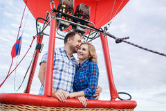 Adventure. Beautiful romantic couple hugging in bascket hot air balloon Royalty Free Stock Photography