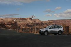 Adventure Begins. Suv parked near canyon ready to begin the adventure royalty free stock image