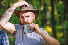 Adventure begins from first sip. Alcohol drink. Nomadic man carry alcohol with him. Guy brutal bearded cowboy drink. Alcohol metal flask. Hipster with beard stock photos