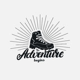 The adventure begins hand written lettering. Stock Photo