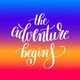 The adventure begins handwritten positive inspirational quote Royalty Free Stock Photo