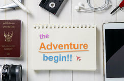 The Adventure Begins text on a book for travel agency banner. Royalty Free Stock Photos