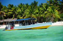 Adventure boat for scuba diving near the beach on Soana island Royalty Free Stock Photos