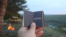 Adventure. Book with the inscription and forested mountain. Travel or traveling idea. Book with the inscription adventure. Forest on background stock video footage
