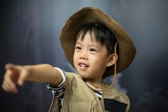A adventure boy is preparing a camera and a binocular. A adventure boy is preparing a camera and a binocular for travel the jungle Royalty Free Stock Photos