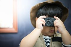A adventure boy is preparing a camera and a binocular. A adventure boy is preparing a camera and a binocular for travel the jungle Royalty Free Stock Photography