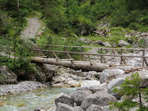 Adventure bridge crossing rocky creek Royalty Free Stock Image