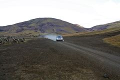 An adventure by car in long endless paths of volcanic sand. Traveling by car the endless volcanic paths of the interior lands of Iceland. An adventure by car in royalty free stock image