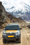 Adventure car with snow mountain background. Adventure car on the way to Chopta Valley , Sikkim with snow mountain background Royalty Free Stock Photos