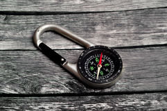Adventure compass on wood Royalty Free Stock Photography