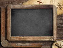 Adventure concept. Blackboard, compass and old map. Stock Photo