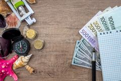 traveler items with money on desk. Royalty Free Stock Image