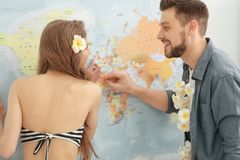 Adventure concept. Young couple imagining future travel. On map background Stock Photography