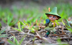 Adventure doll on grass Royalty Free Stock Images