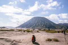The adventure driving mortocycle into Beautiful active Volcano mt Bromo royalty free stock photography