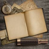 Adventure and exploration concept. Diary and vintage travel accessories on desk top. stock photos