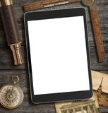 Adventure, exploration and travel concept with modern tablet PC royalty free stock photo