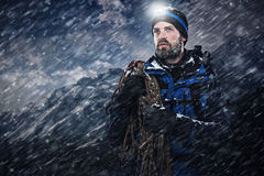 Adventure explorer mountain man. Adventure mountain man in snow blizzard looking on with determination and courage Royalty Free Stock Image
