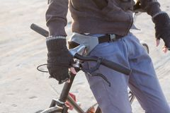 Adventure on fixed gear bicycle in desrt. Alone rider on fixed gear road bike riding in the desert near river, hipster tourist bicycle rider pictures Stock Photos