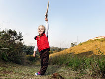 Adventure girl. Young girl playing pretend explorer adventure game outdoors. cute young child having fun royalty free stock photography
