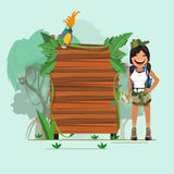 Adventure girl with presenting jungle wood board -  Stock Images