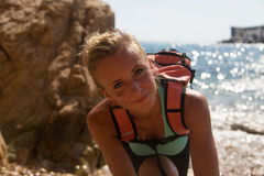 Adventure girl smiling. Happy on the wild coast Stock Photos