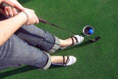 Adventure Golf 2. Putting a ball at an adventure golf Stock Image