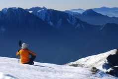 Adventure guide. Rest on snow slop with beautiful mountain scenic Stock Images