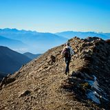 Adventure Hiker near Mountain Summit. Adventure Hiker Hiking to the Mountain Summit on the Pedley Pass trail near Invermere, British Columbia, Canada Stock Images