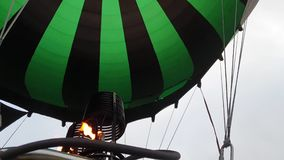 Adventure on hot air balloon watermelon. Burner directing flame into envelope. The aircraft fly in morning blue sky due