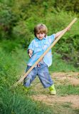 Adventure hunting for treasures. Little helper working in garden. Cute child in nature having fun with shovel. I want to. Find treasures. Little boy with shovel royalty free stock images