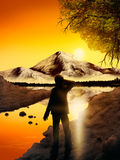 Adventure Landscape. Digital painting of a silhouetted man standing before a mountain reflected in a lake Royalty Free Stock Photography