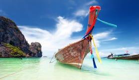 Adventure landscape background. Wooden fishing boat on sea coast Royalty Free Stock Photography