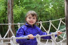Adventure little girl on jungle park rope bridge Royalty Free Stock Photography