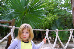 Adventure little girl on jungle park rope bridge Stock Photo