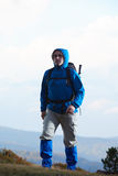 Adventure man with backpack hiking Stock Photos