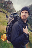 Adventure man. Potrait of adventure trekking man in mountains with backpack Royalty Free Stock Images