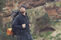 Adventure man. Potrait of adventure trekking man in mountains with backpack Stock Photos