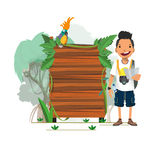 Adventure man with presenting jungle wood board -  Royalty Free Stock Image