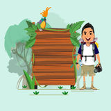 Adventure man with presenting jungle wood board -  Stock Images