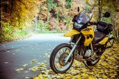 Adventure motorbike. On road in autumn season Stock Photos