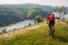 Adventure mountain biking on riverside Royalty Free Stock Photo