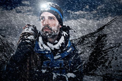 Adventure mountain man. In snow expedition with climbing gear and determination stock photo