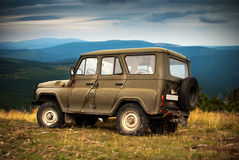 Adventure in the mountains. A jeep parked on a mountain top in Karkonosze Mountains stock photo